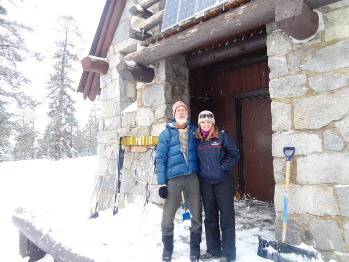 Standing next to legendary Howard Weamer, an Ostrander Ski Hut keeper