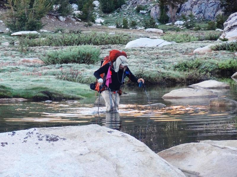 JMT Trail friend Peter Aan crossing a stream in Evolution Valley