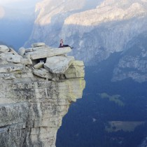 Sitting on the top of diving board. Top of Half Dome