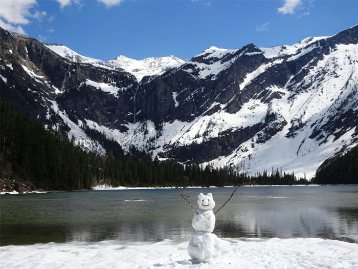 Snowman raising the hands at Avalanche Lake -Glacier National Park